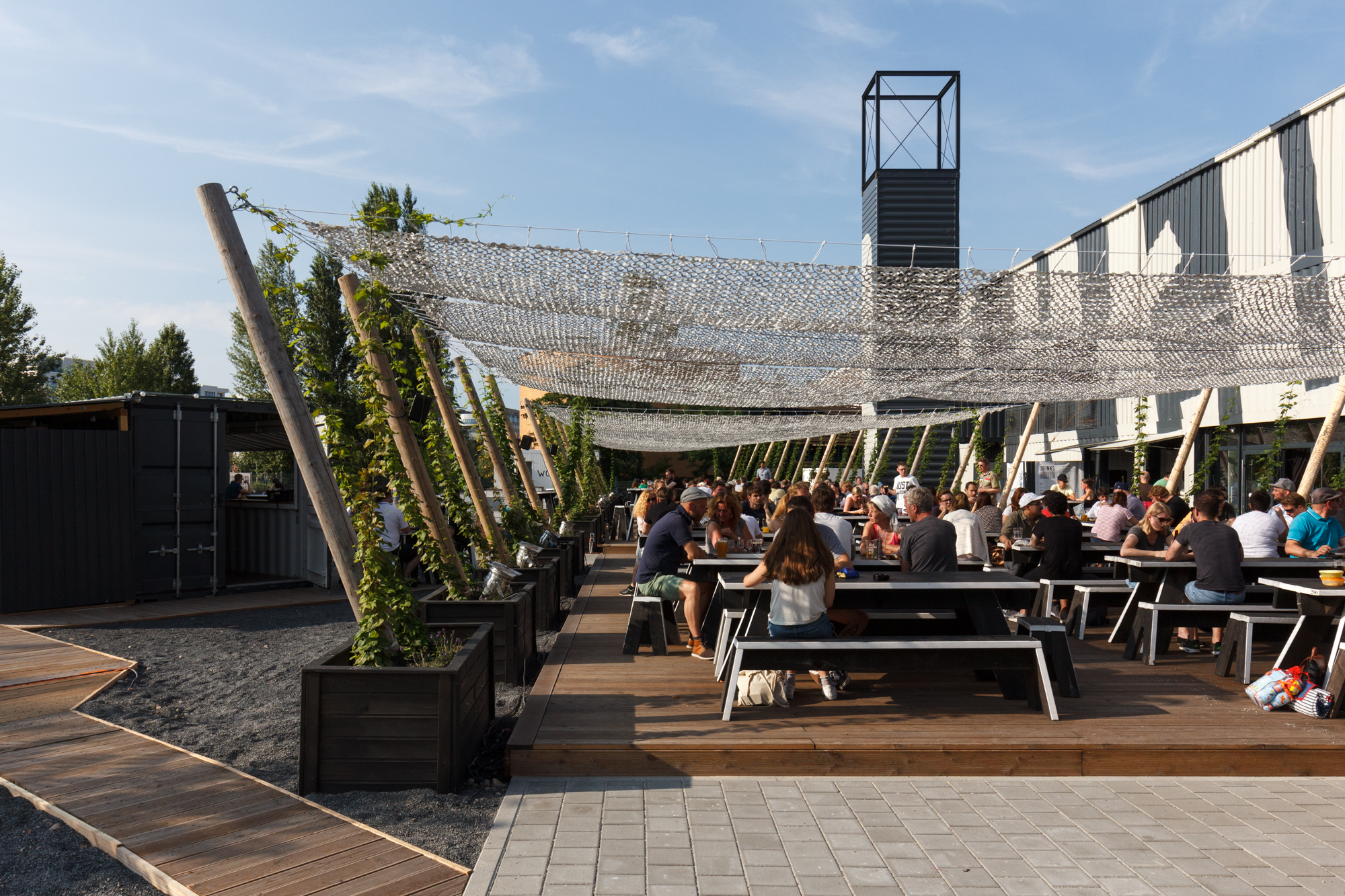 The beer garden at BRLO Brwhouse - a craft beer brewery, bar, restaurant and beer garden and the edge of Park am Gleisdreieck in Berlin
