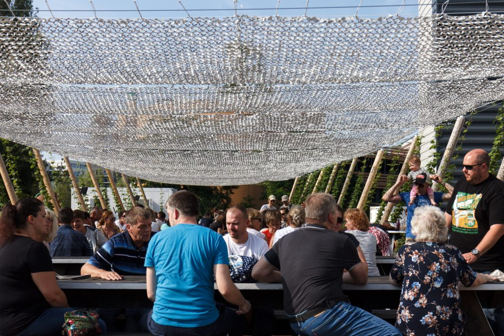 Enjoying the sunny weather in the beer garden at BRLO Brwhouse - a craft beer brewery, bar, restaurant and beer garden and the edge of Park am Gleisdreieck in Berlin