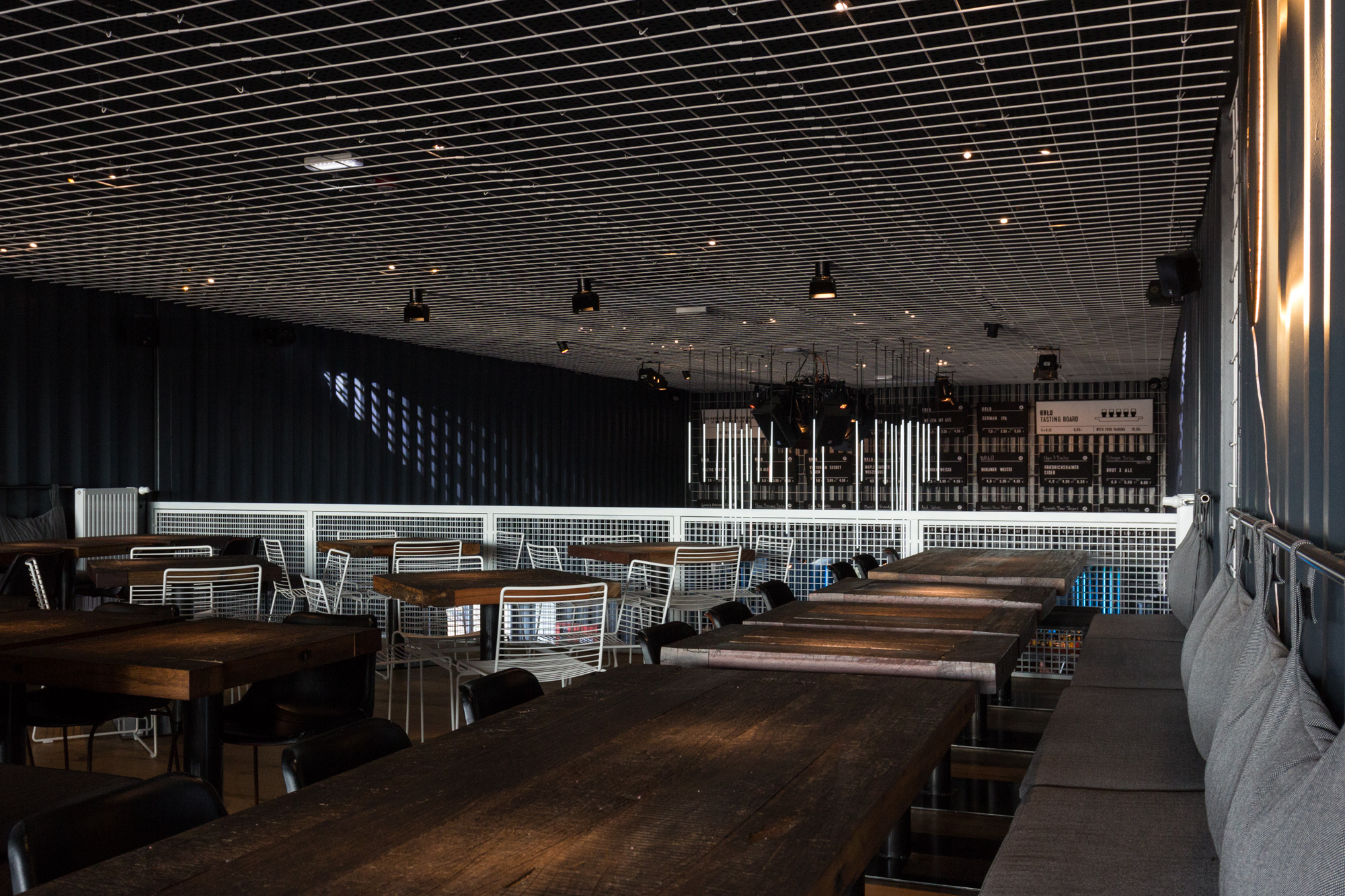 Seating and tables on the mezzanine level at BRLO Brwhouse - a craft beer brewery, bar, restaurant and beer garden and the edge of Park am Gleisdreieck in Berlin