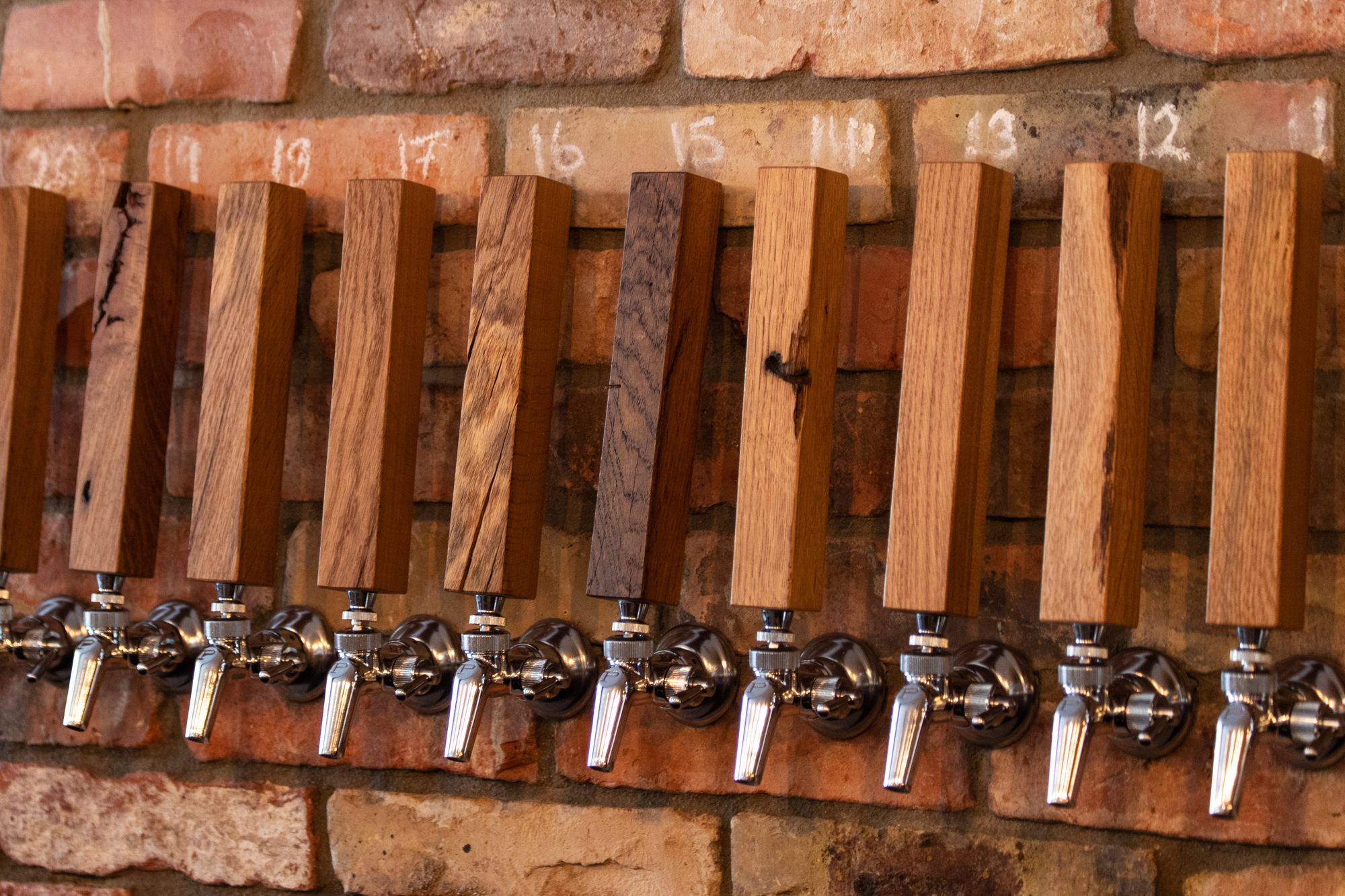 Wooden taps at Muted Horn, a craft beer bar in Berlin Neukölln